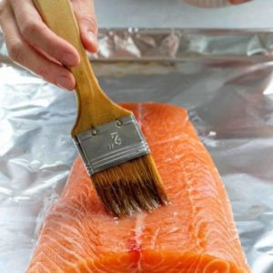 Brush tops of salmon filets with melted butter
