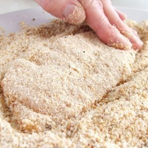 Follow by covering all sides with seasoned bread crumbs.