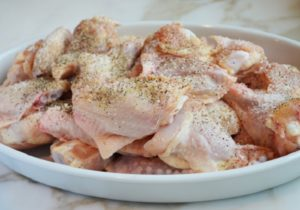 Season wings all over with salt and pepper