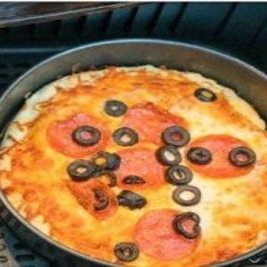 Spread sauce over dough
