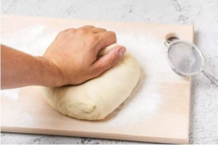 Then knead once more, adding flour as needed if the dough is sticky.